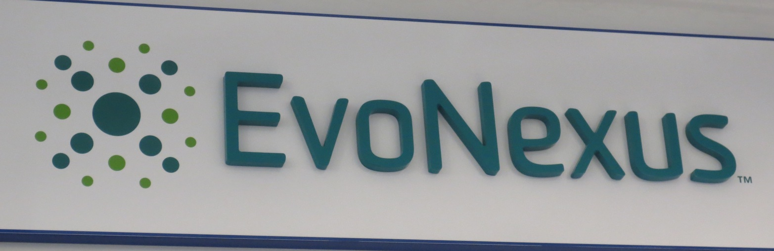 EvoNexus logo on their wall of their incubator space