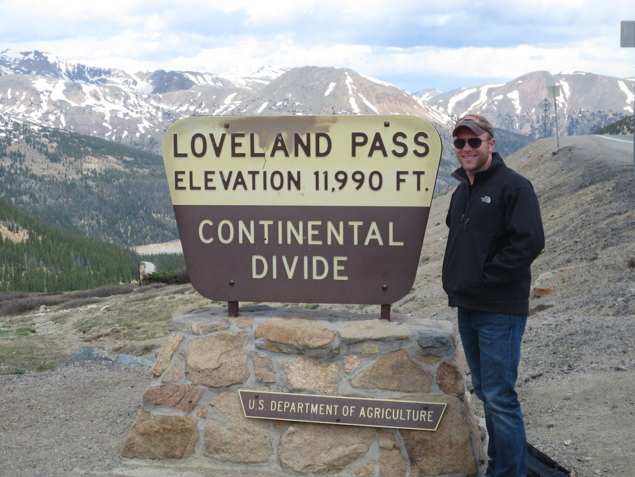 Matt Makai to the left of the Loveland Pass sign.