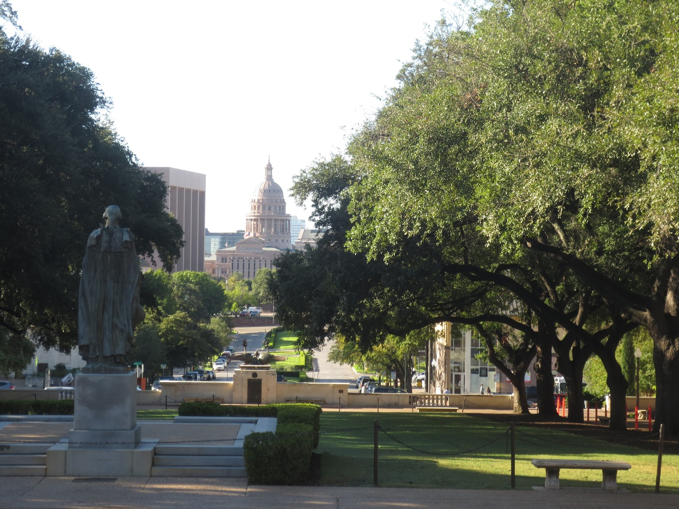 Statue of George Washington overlooking the Austin Capitol building.
