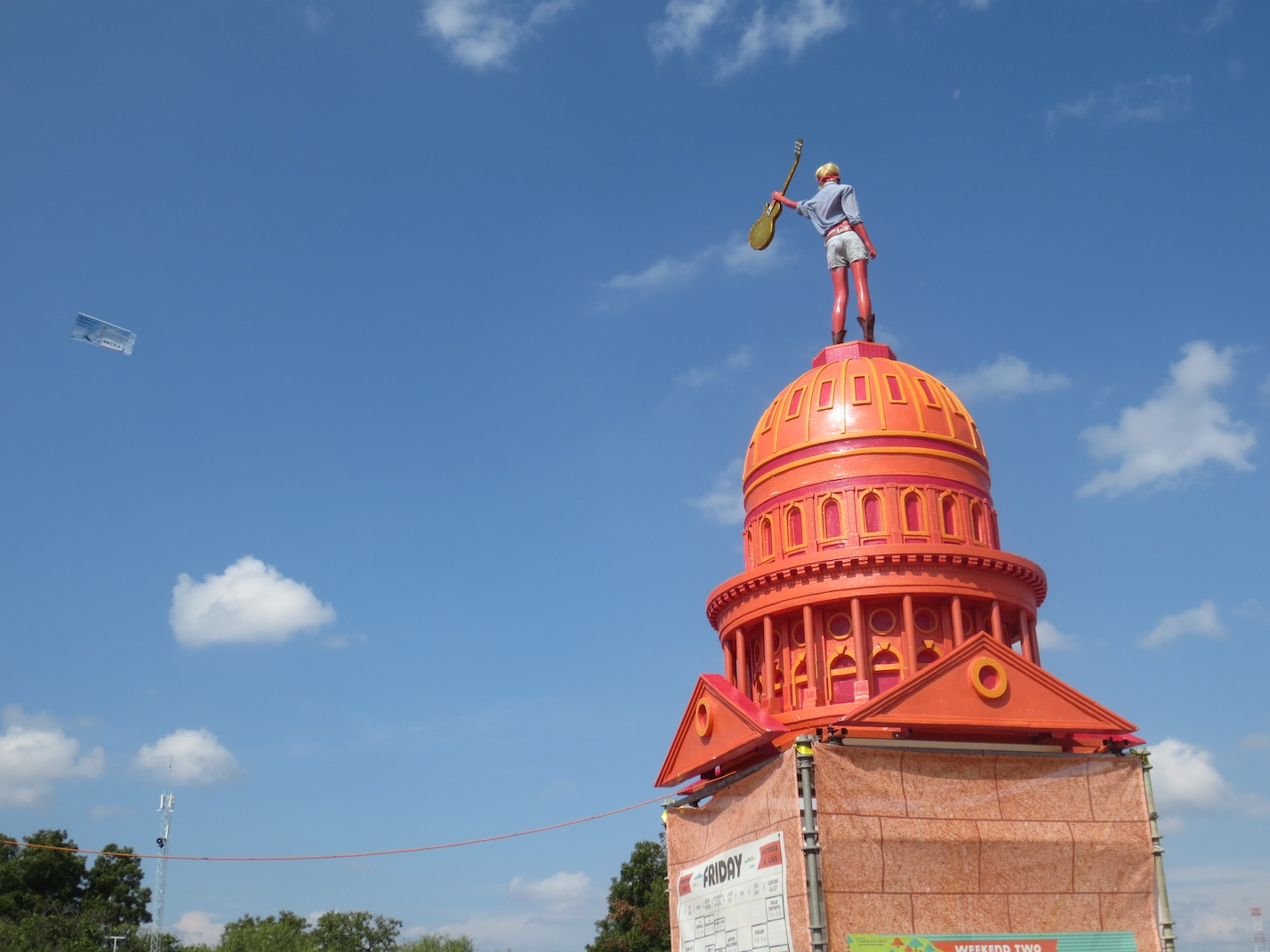 Statue on top of an orange painted version of the State Capitol.